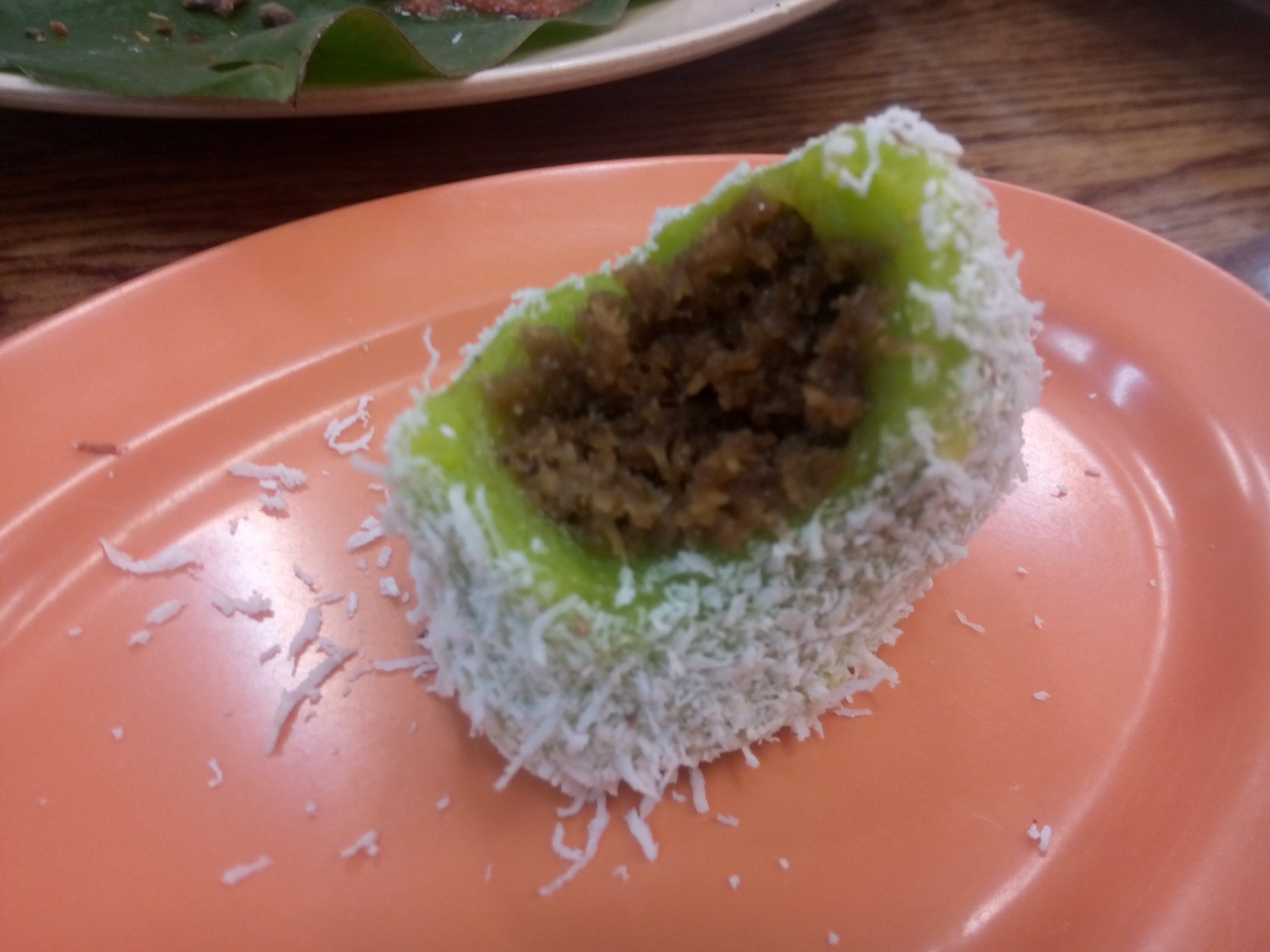 Coconut ball, bright green with brown mush inside