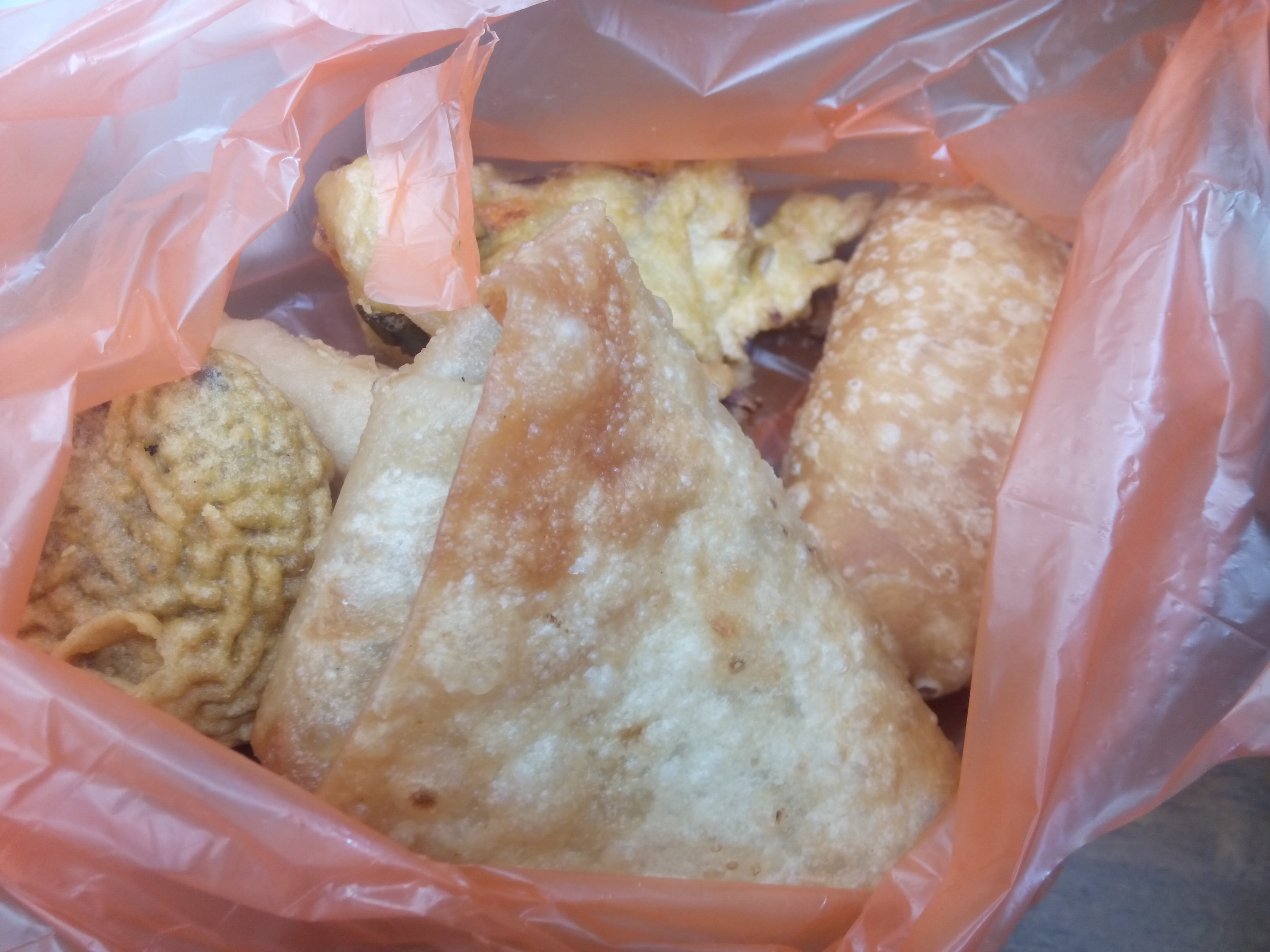 Fried Indian food in a plastic bag