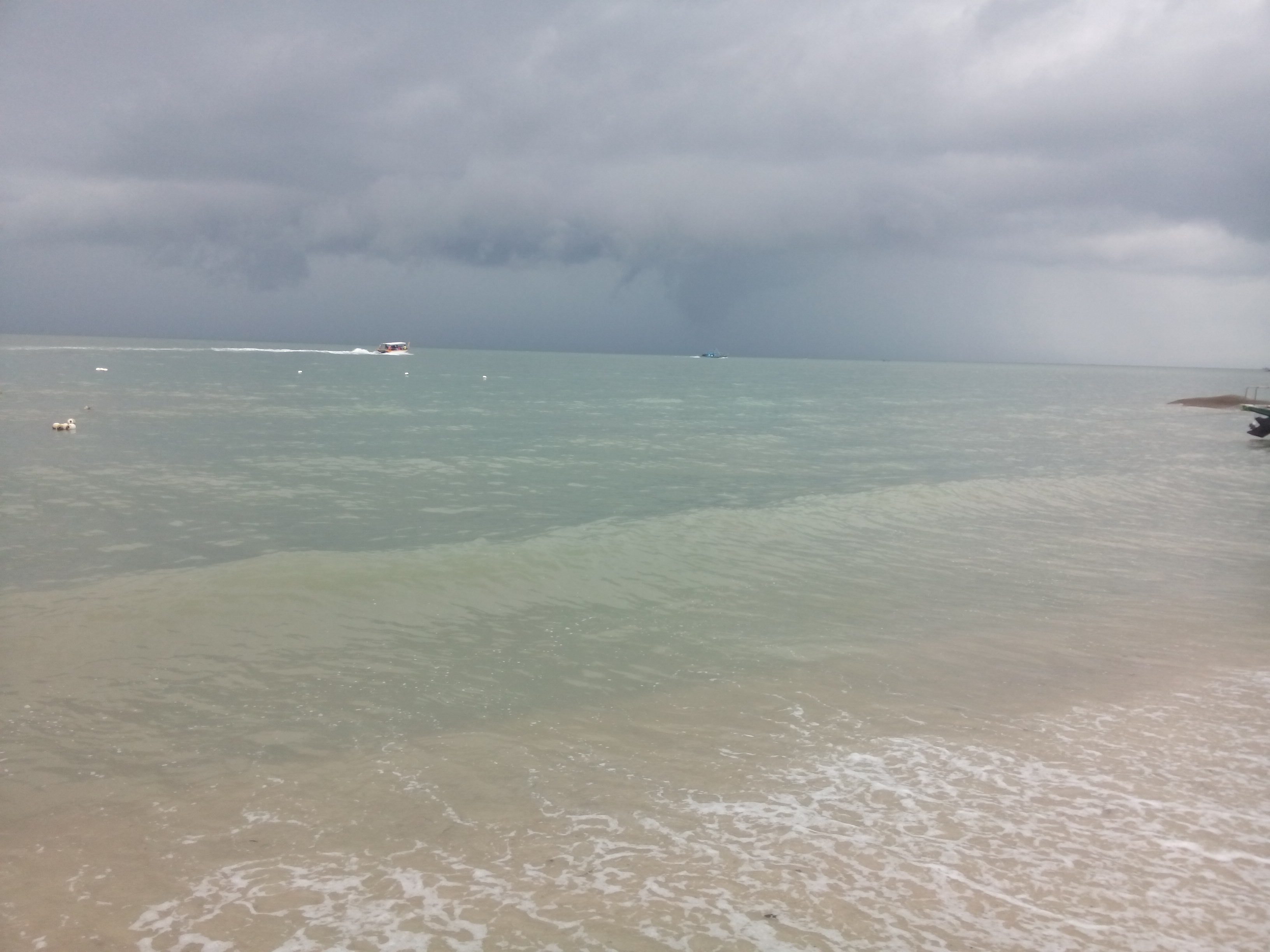 The sea with dark storm clouds in the distance