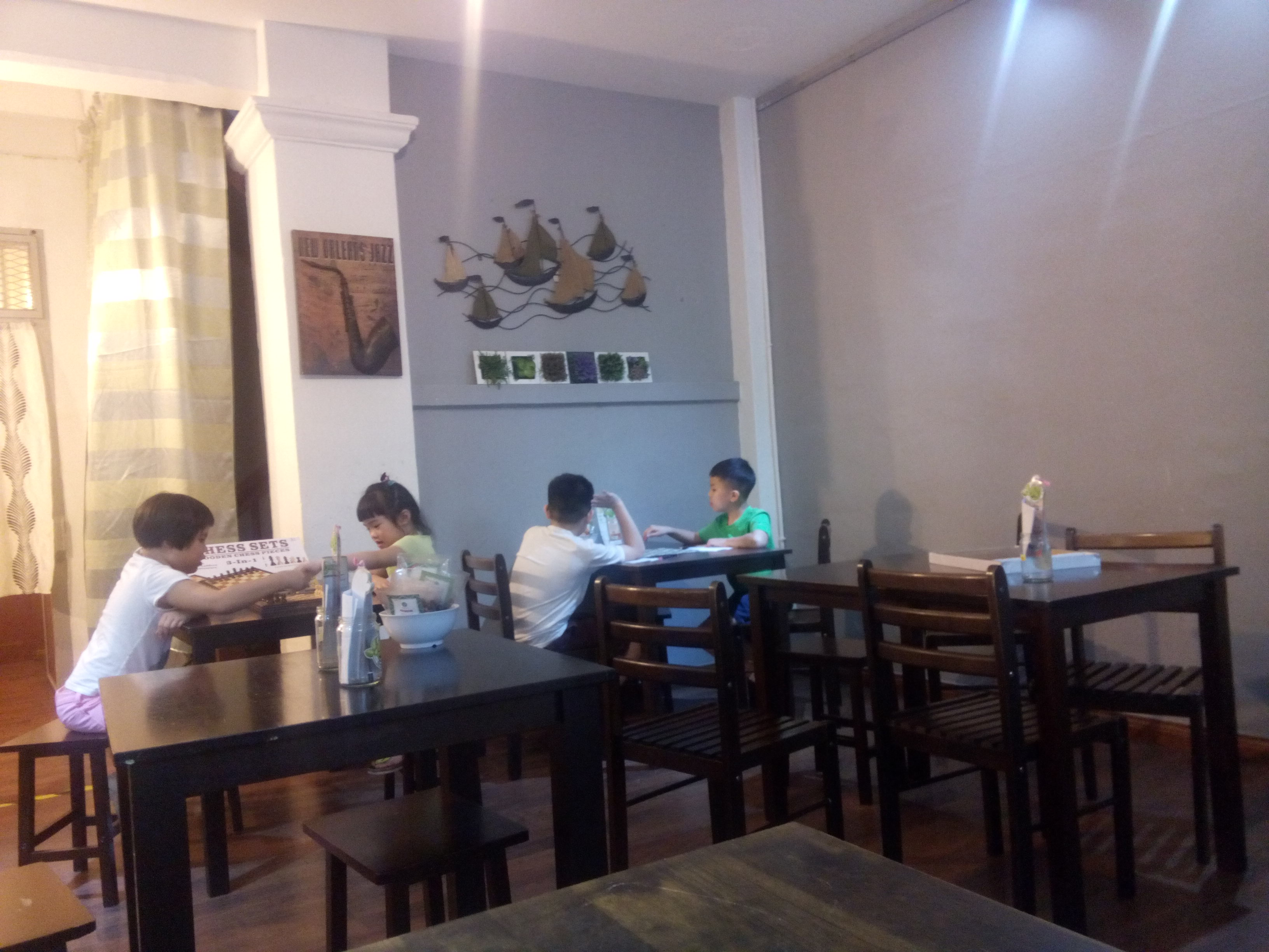 Kids sitting at tables in a restaurant
