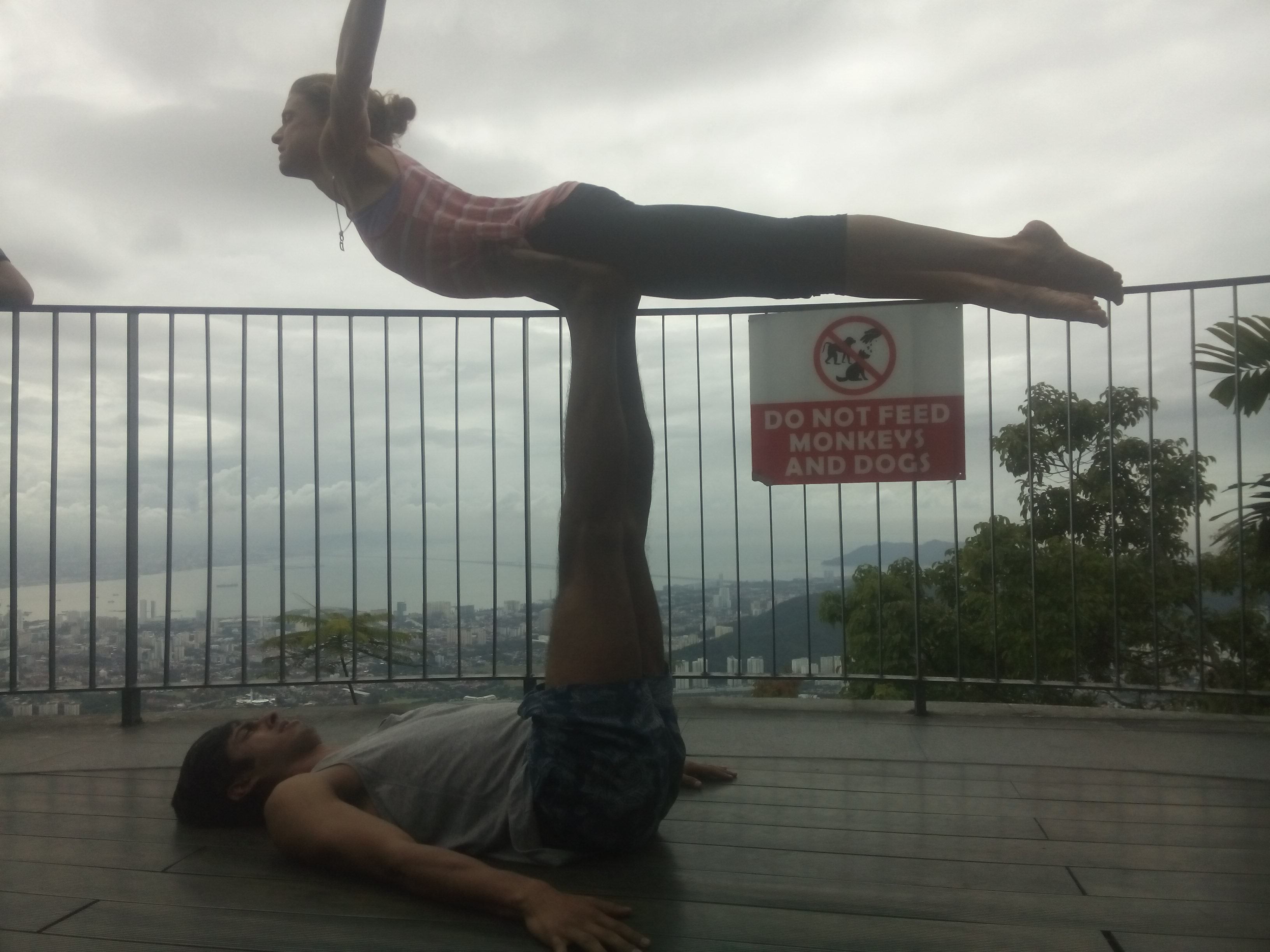 Two people doing acro yoga