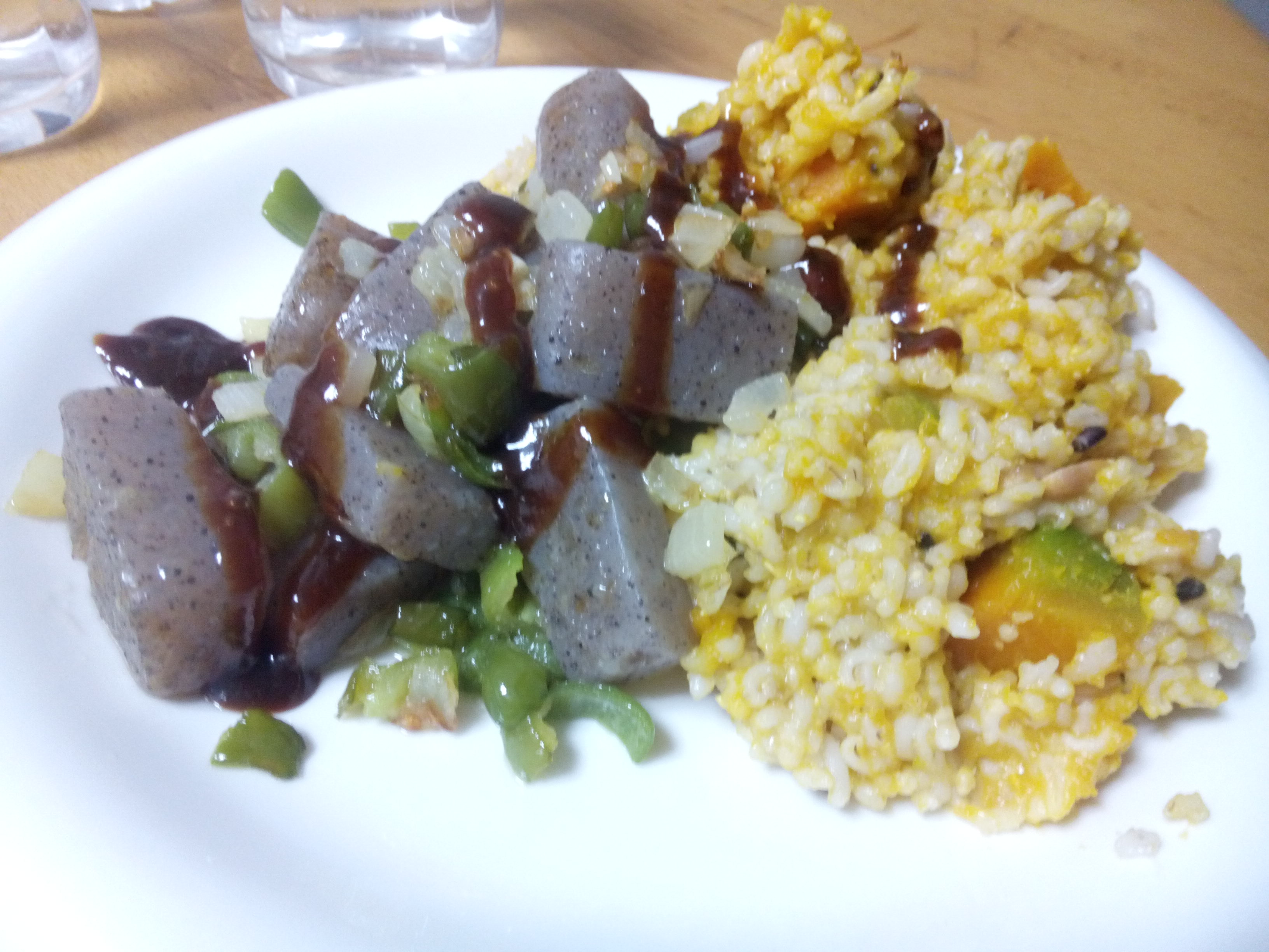 Prepared konnyaku (boiled then lightly fried), with sauce drizzled, and pumpkin rice.