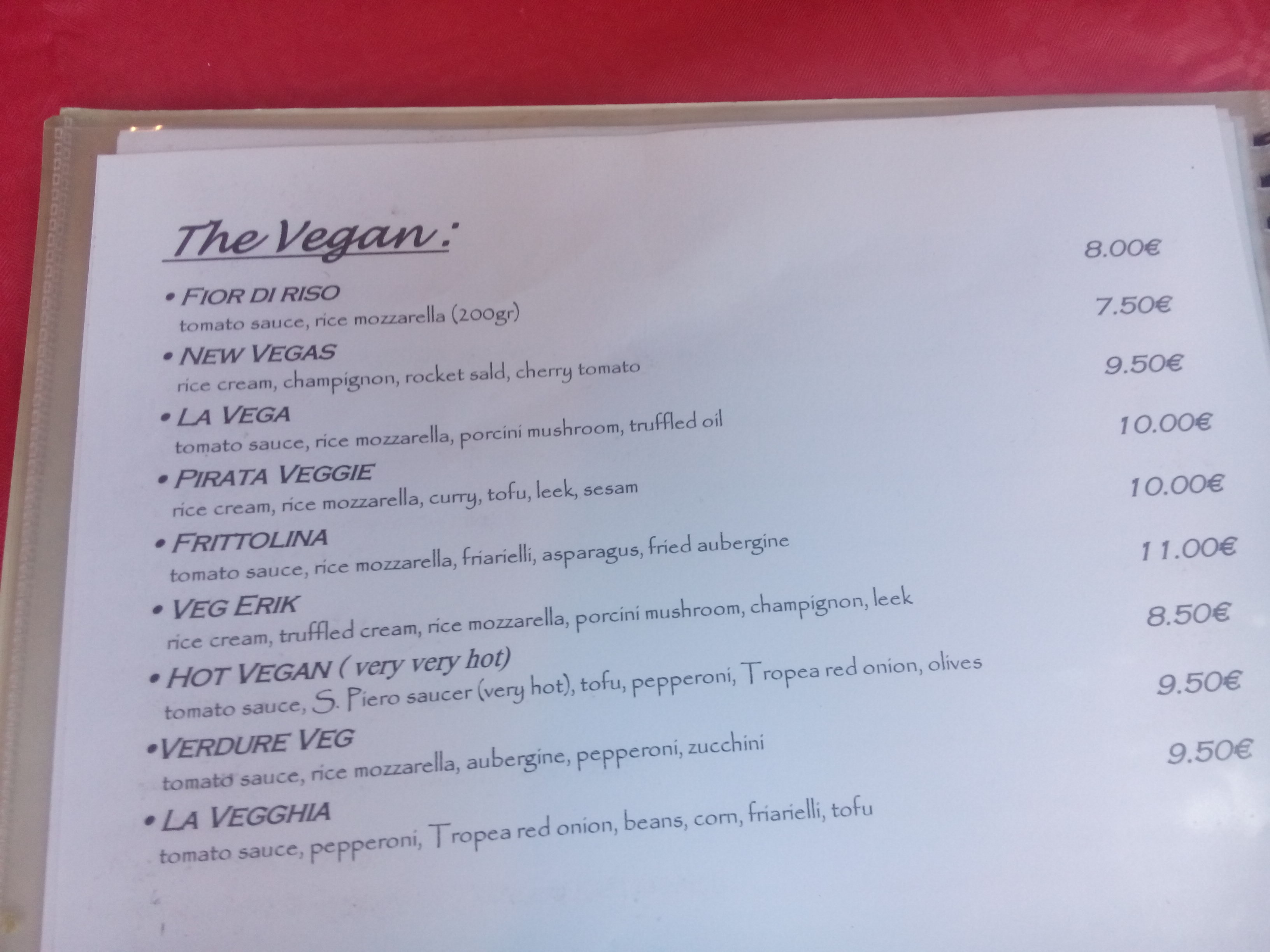 A menu with vegan pizzas listed