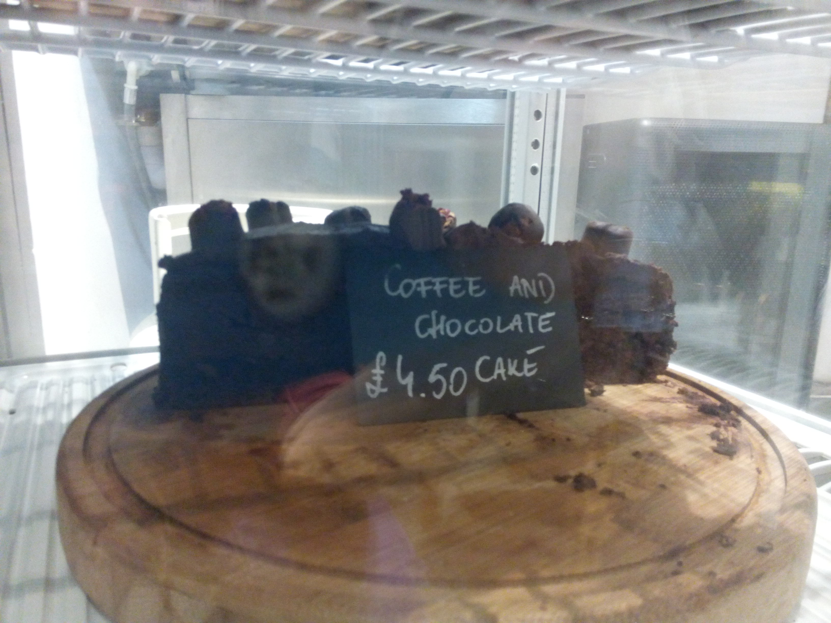 Chocolate coffee cake behind glass