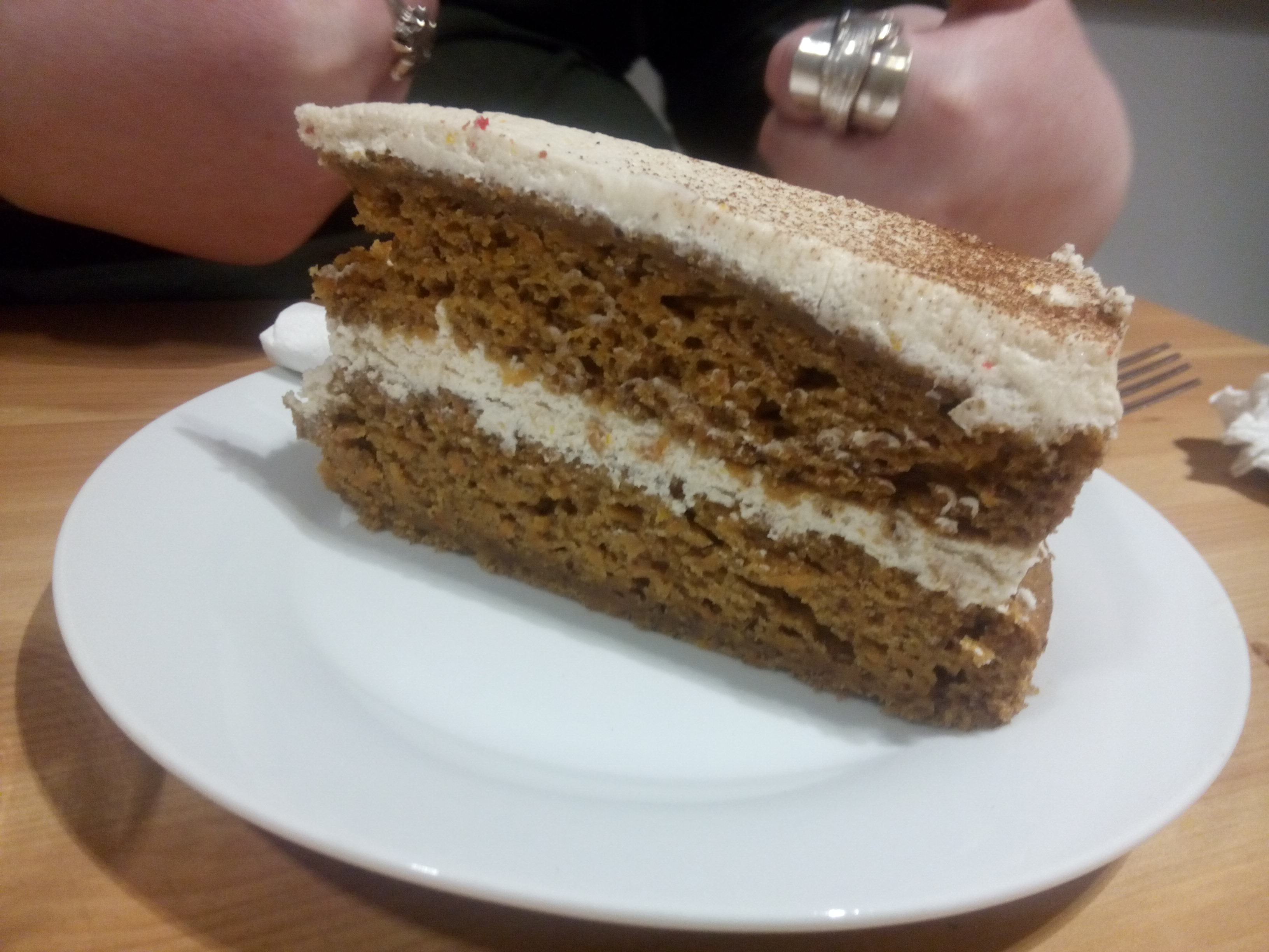 Carrot cake slice from the side on a plate