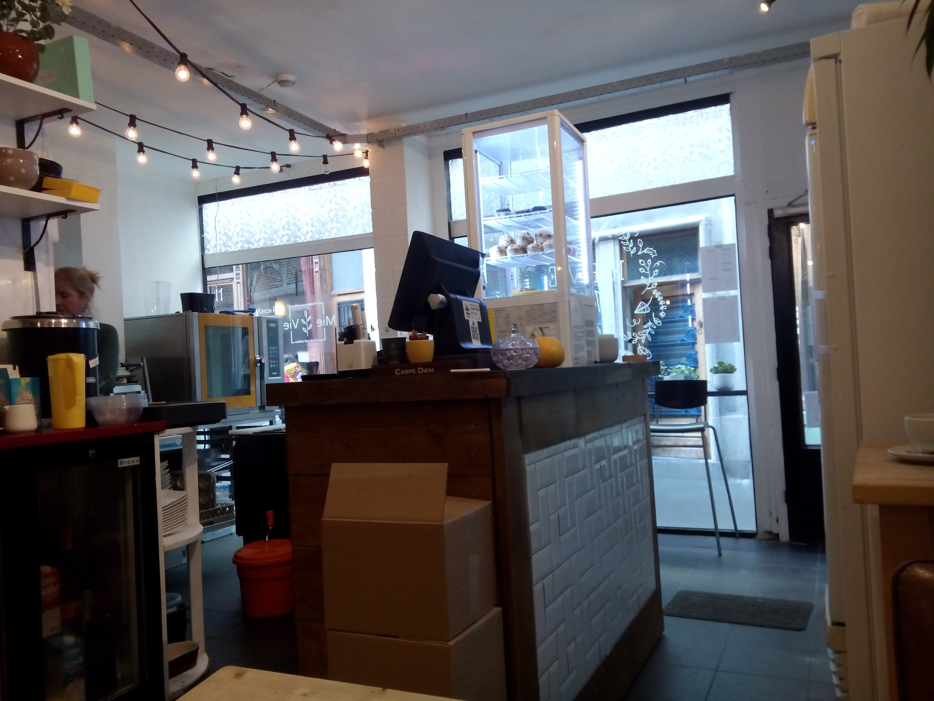 A cafe counter and front door from inside