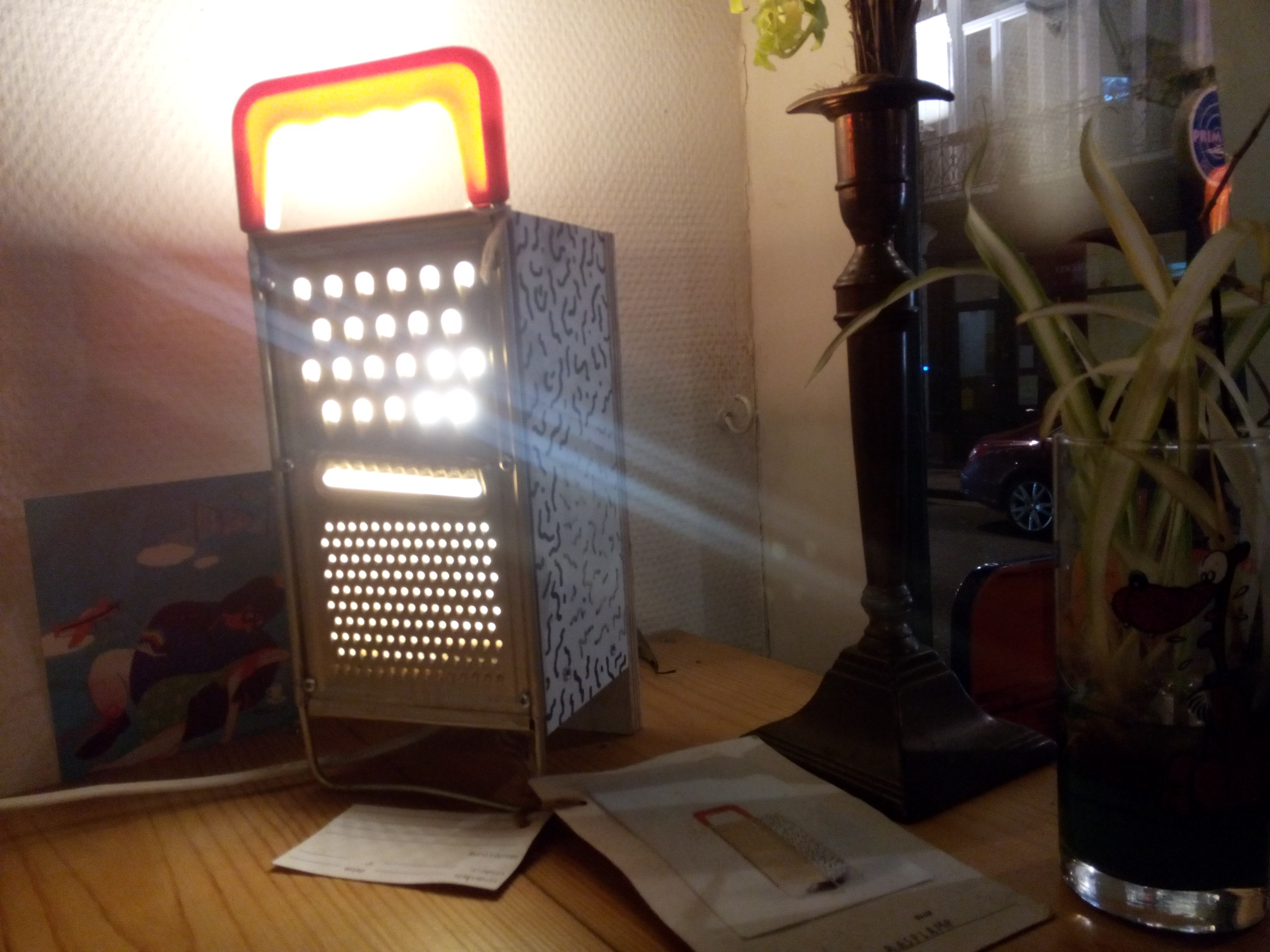 A cheesegrater with light coming from inside