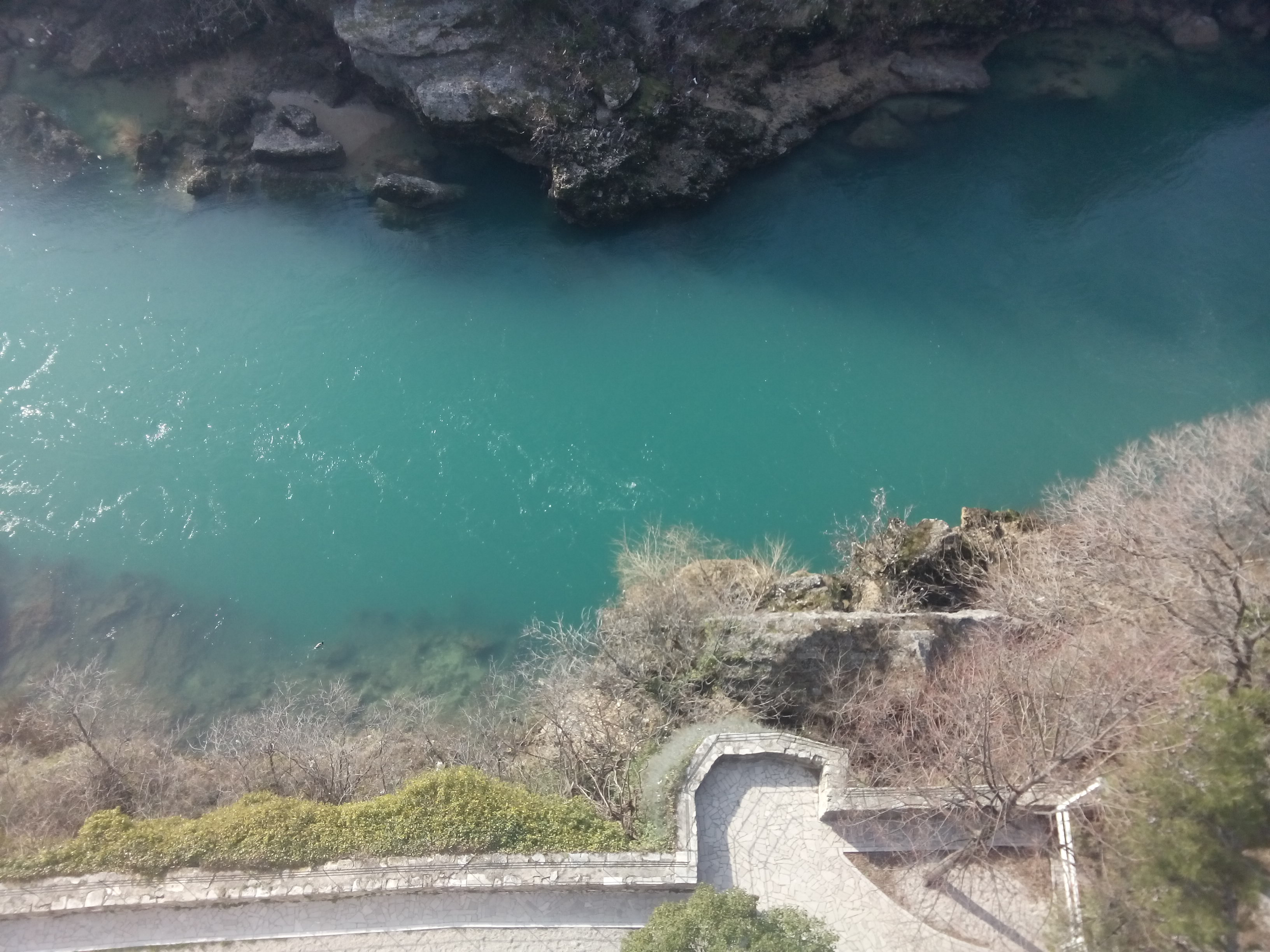 A bright blue-green river from above