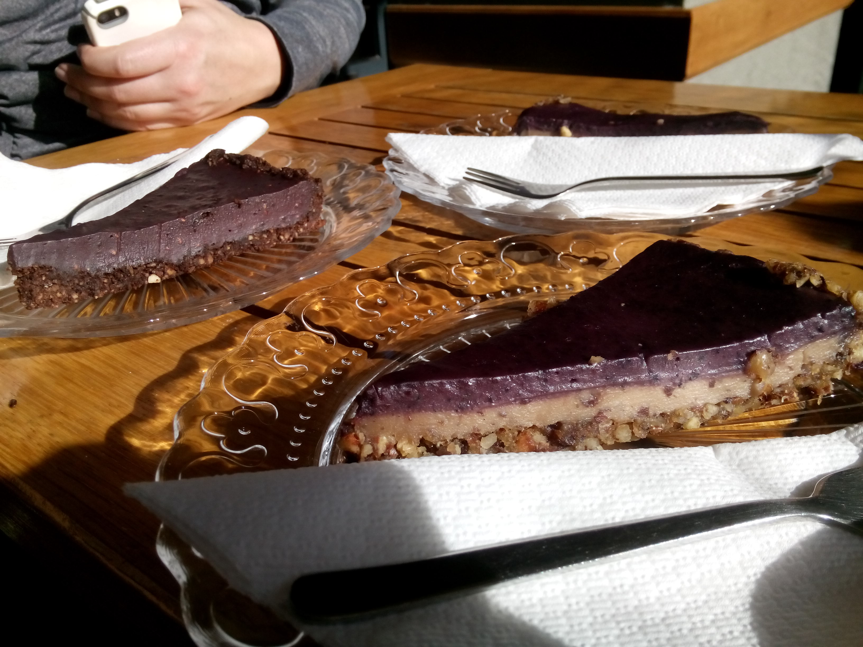 Purple triangluar shaped slices of cake on glass plates