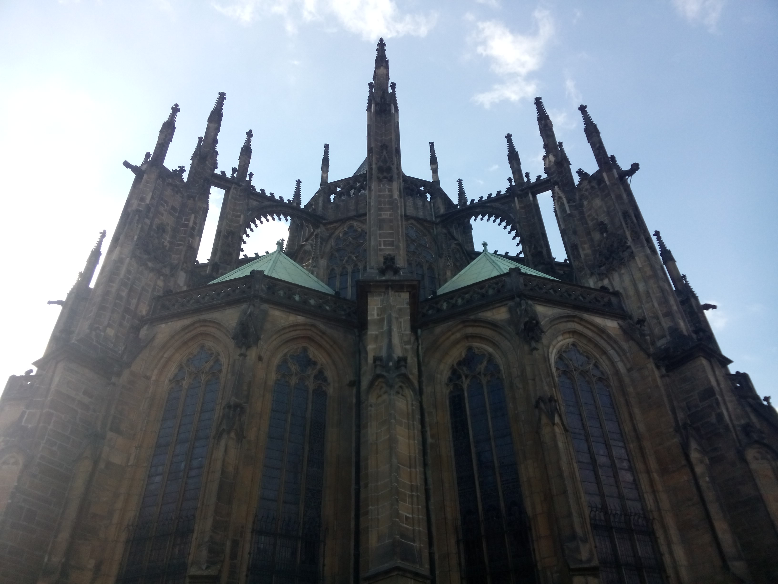 Gothic cathedral spires, tall windows, green copper roofs