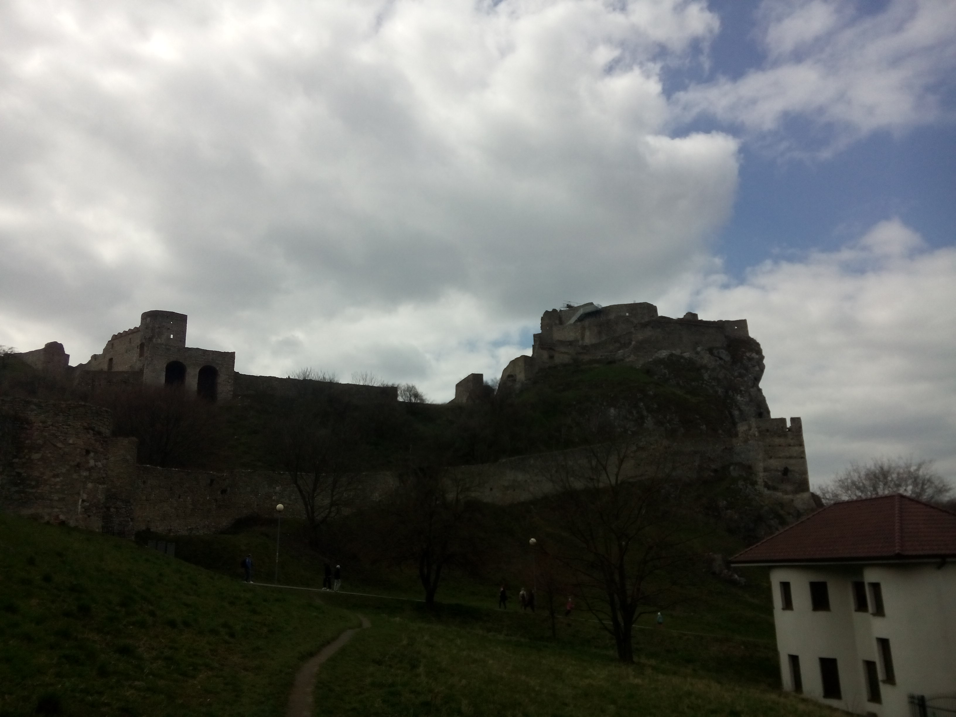 A distant castle on a hill, with white and blue sky