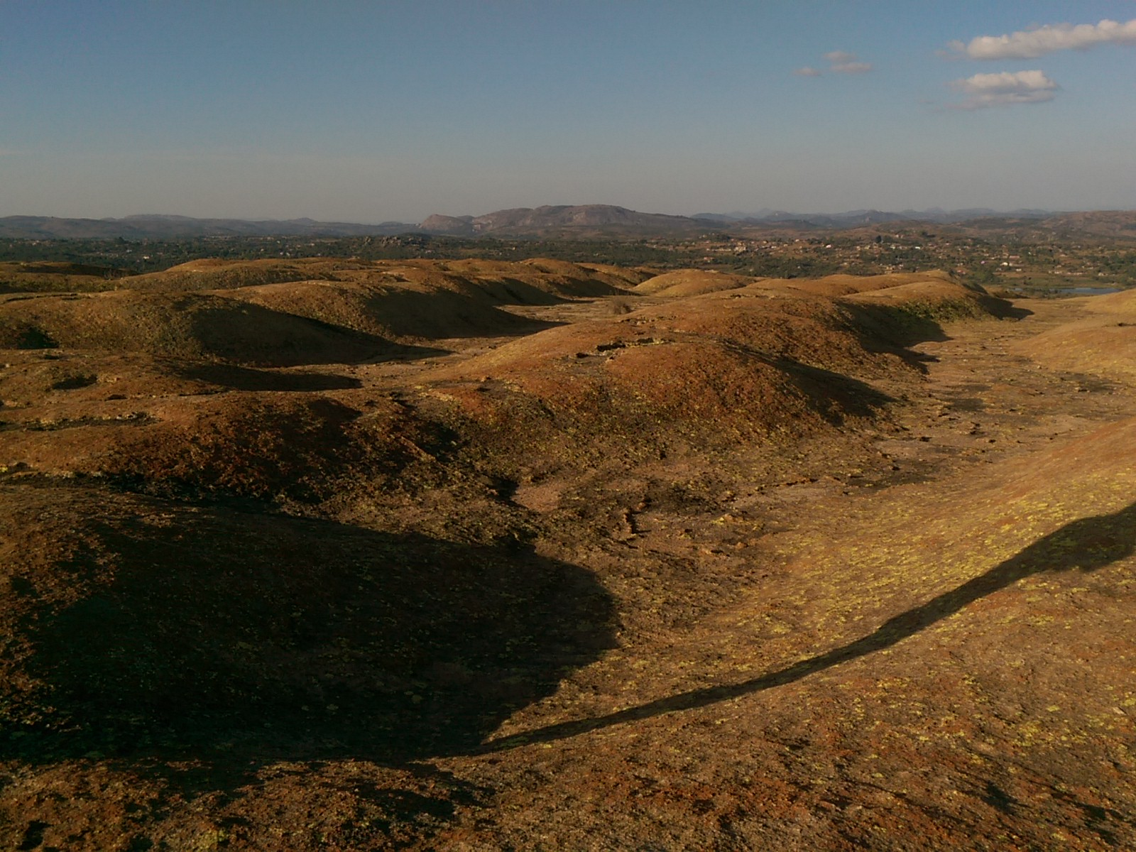 Epic landscape view of rolling granite hills and a blue sky