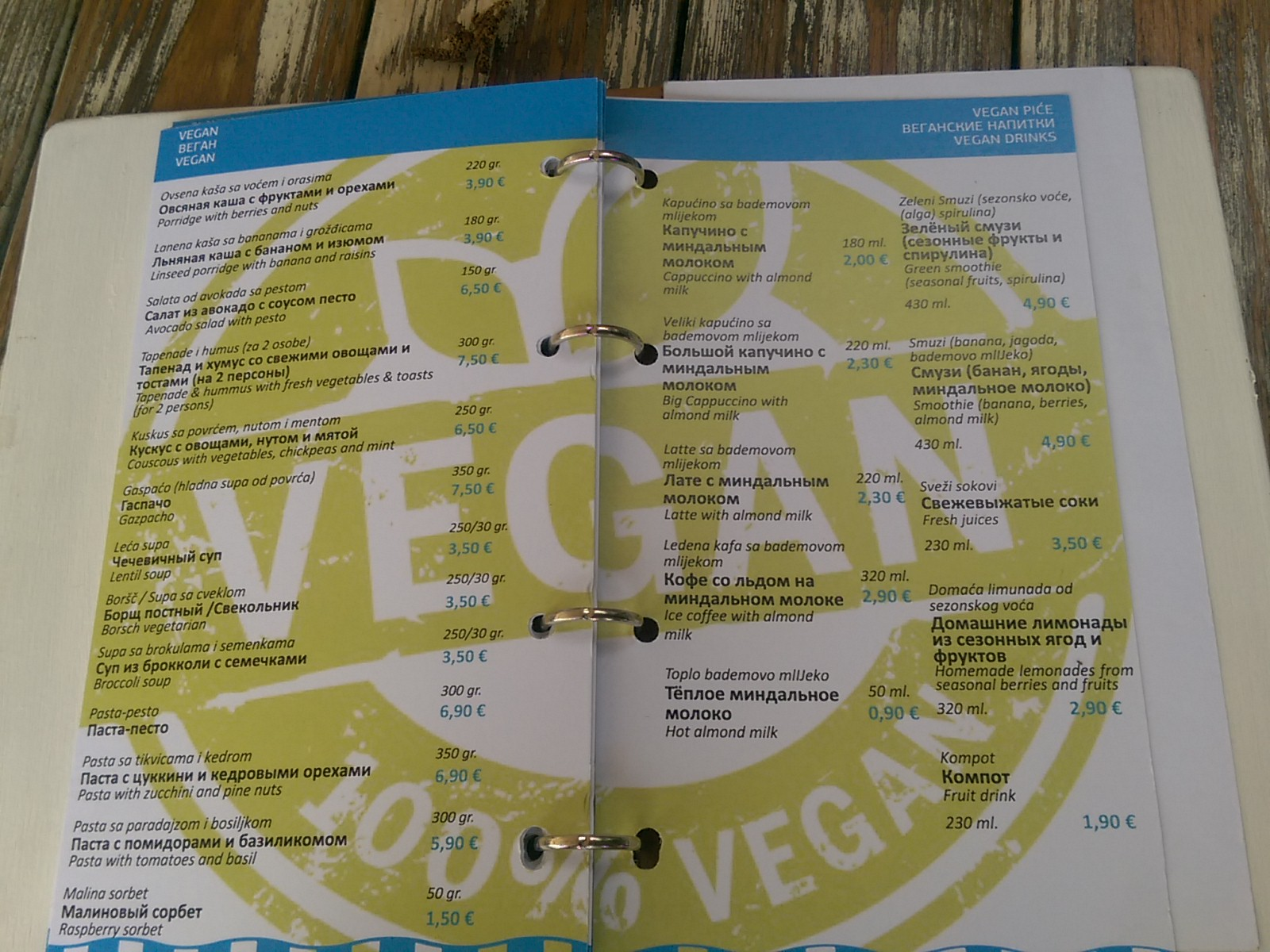 An open menu on a table with VEGAN watermark