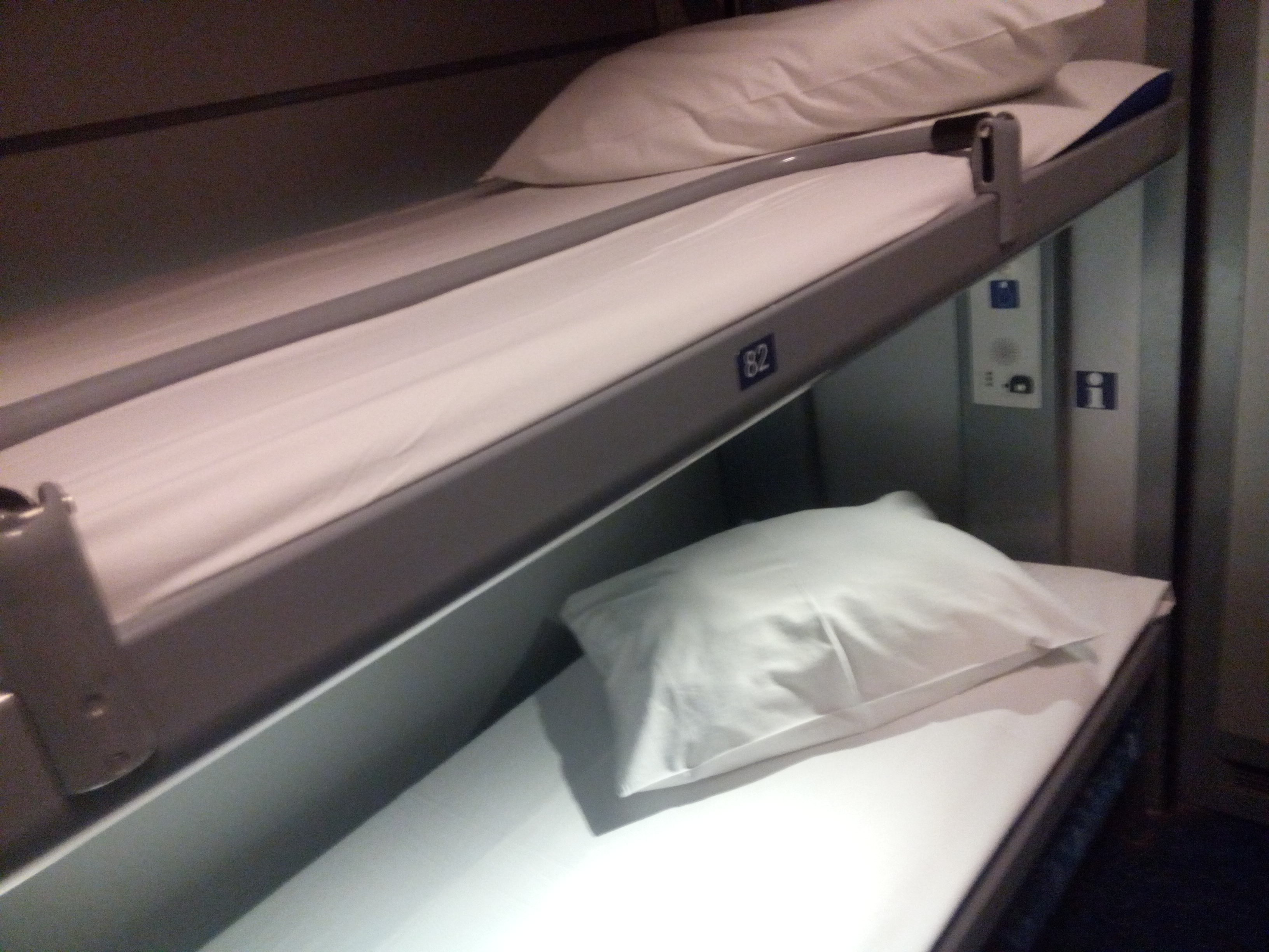 Two narrow bunks in a train cabin