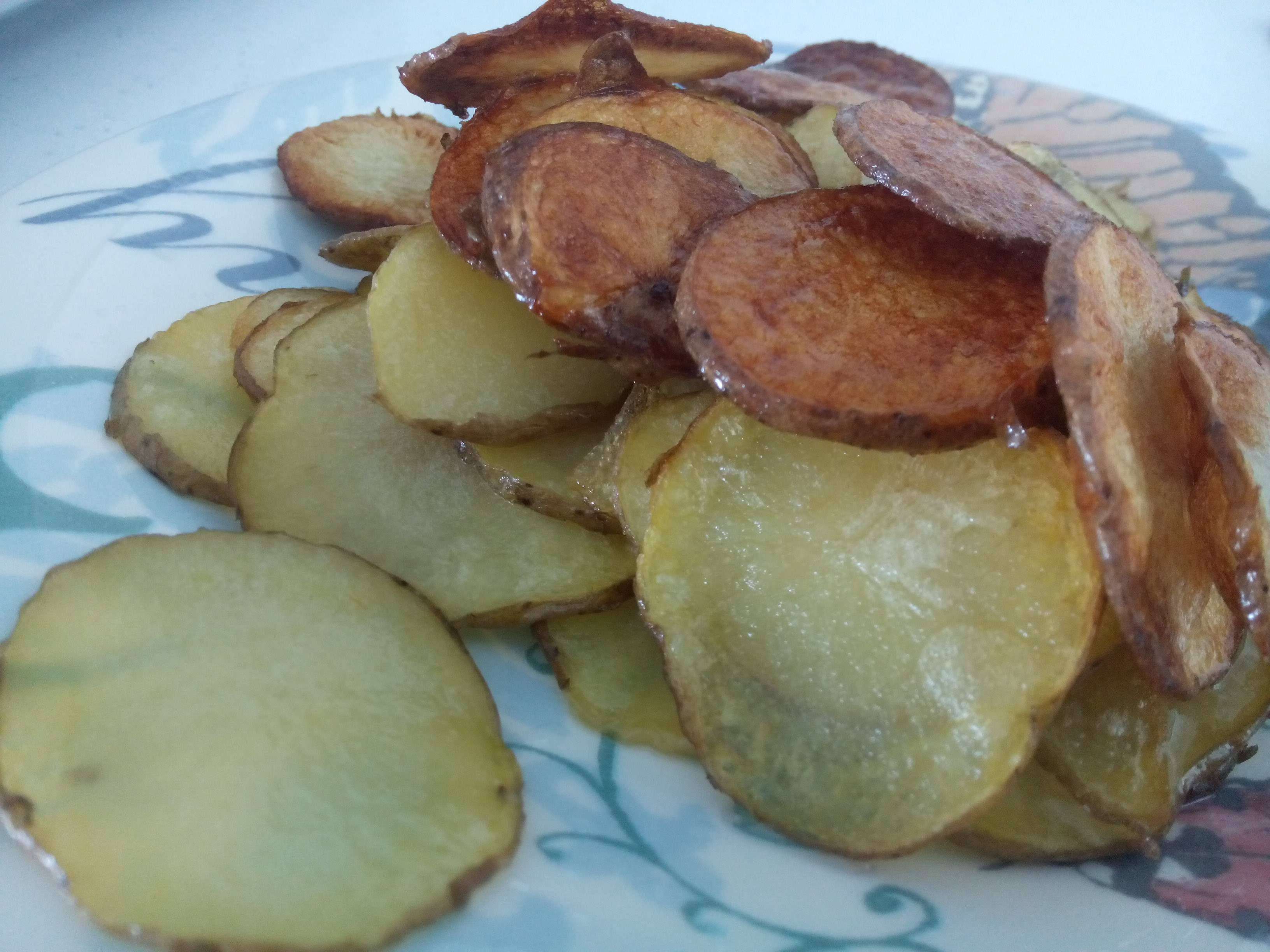 Fried sliced potato on a plate