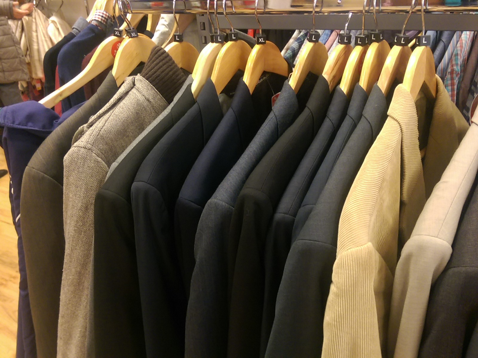 A rack of suit jackets in a shop