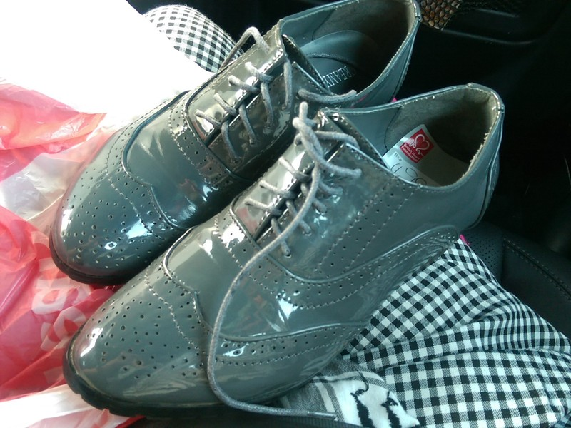 Shiny grey brogue shoes
